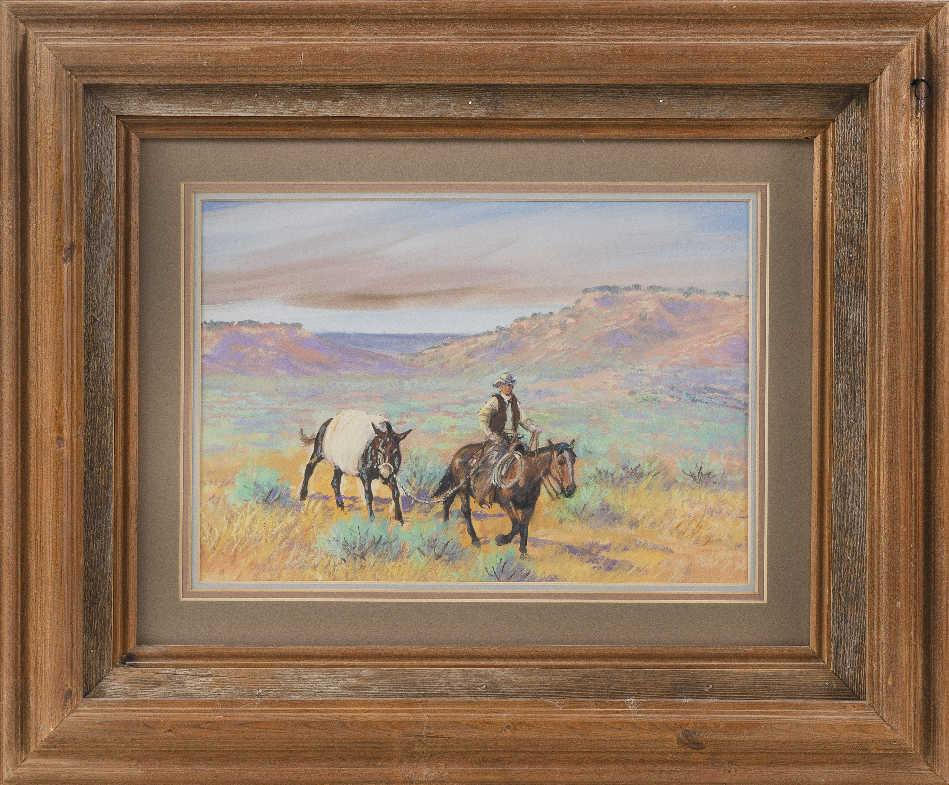 JIM (JAMES) FRANK WARD (Texas/Oklahoma, 1931-2012), Western landscape with a cowboy on horseback leading a donkey., Pastel, 8.5