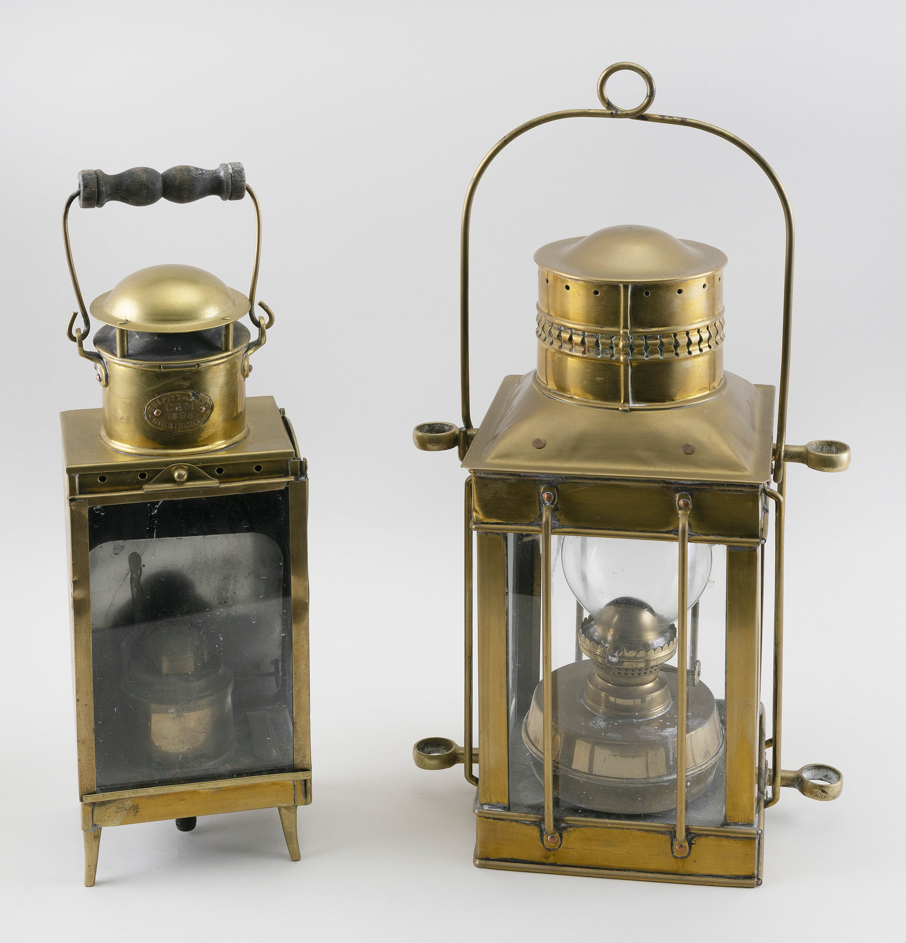 TWO BRASS SHIP'S LANTERNS Late 19th Century Heights exclusive of handles 14.5