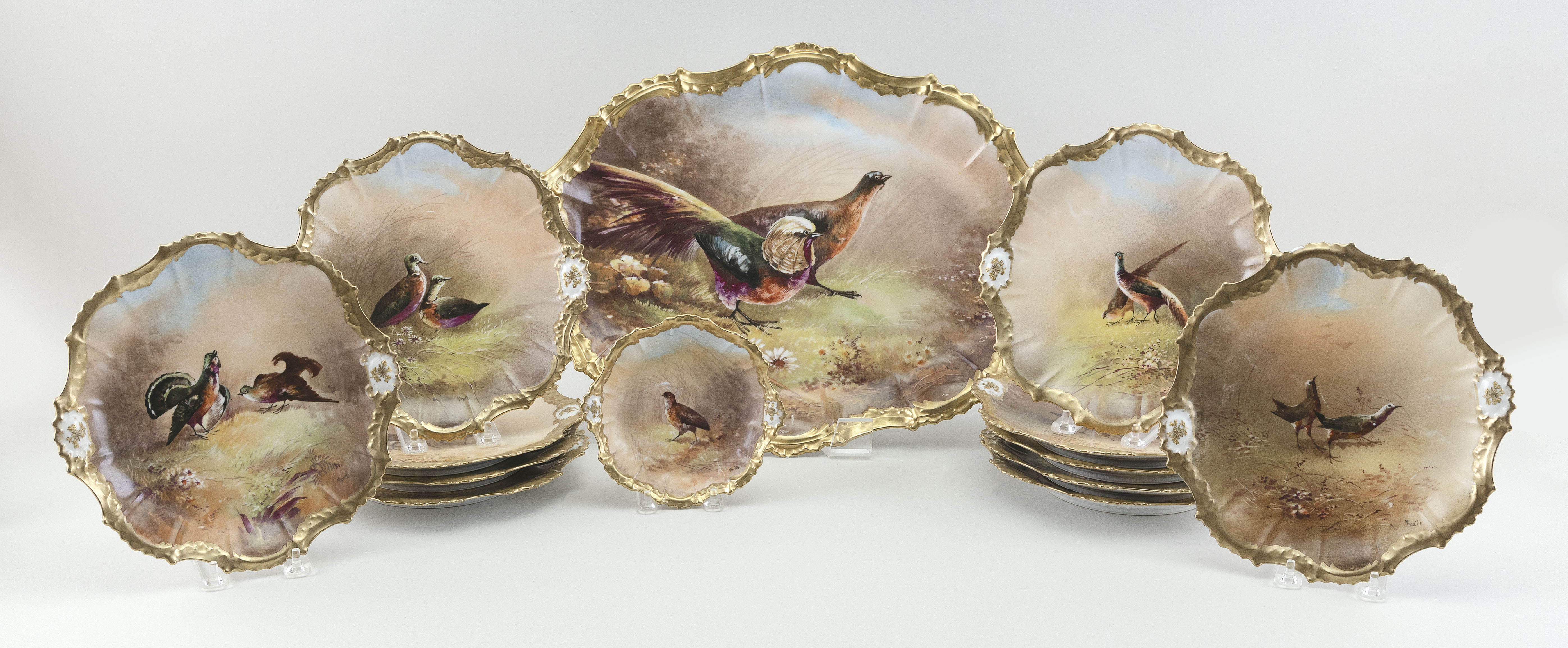 """LIMOGES PORCELAIN PLATTER AND PLATES Early 20th Century Platter length 18.5"""". Plate diameters 9.5"""" and 6""""."""