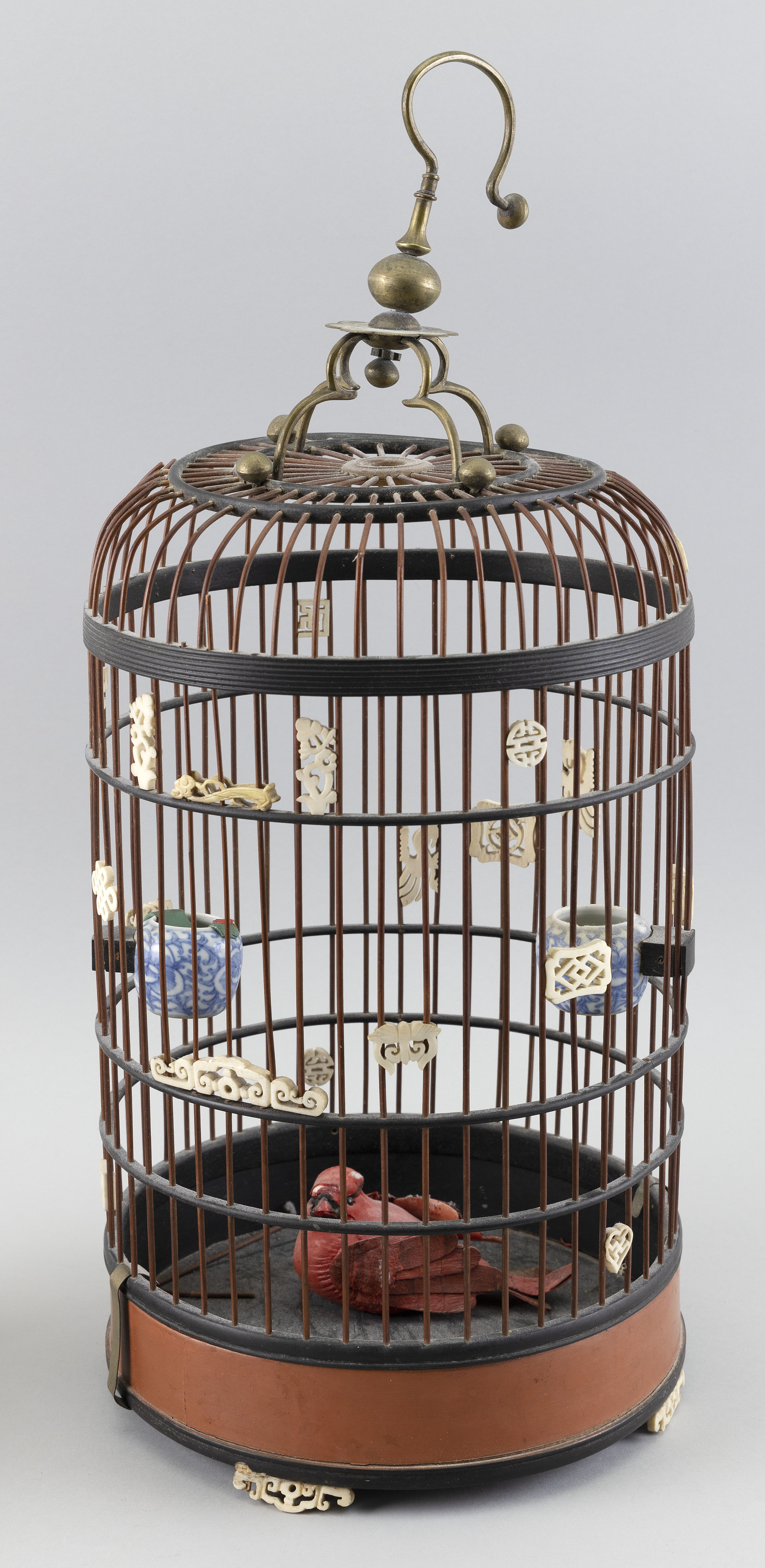 "Image 1 for CHINESE LAQUERED WOOD BIRDCAGE Early 20th Century Height 20.5"". Diameter 9""."