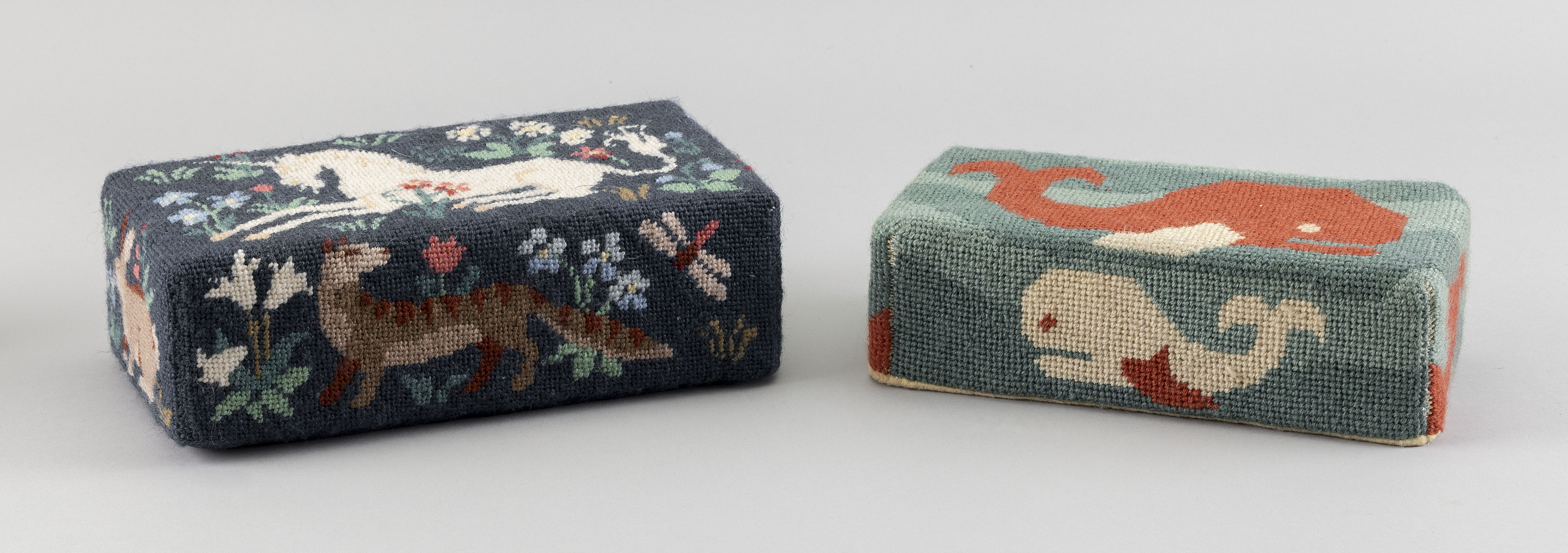 """TWO NEEDLEWORK DOORSTOPS 20th Century Heights 2.5"""" and 3"""". Lengths 8"""" and 8.75""""."""